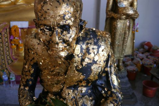 Bust of a Buddhist teacher with gold leaf.