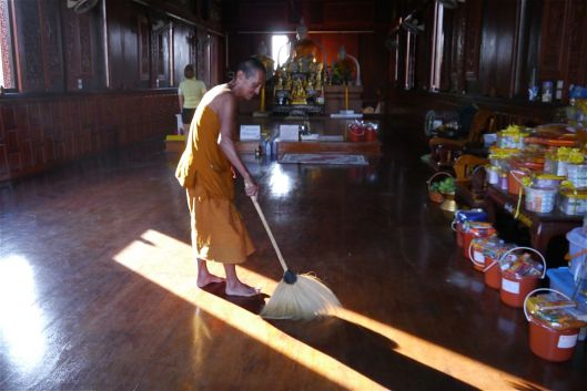 Monk cleaning the temple.